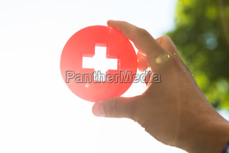 man holding first aid medical sign
