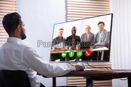 businessman video conferencing with his partner
