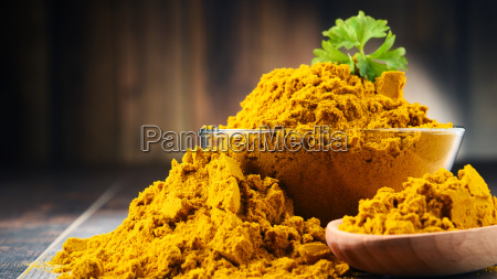 composition with bowl of curry powder
