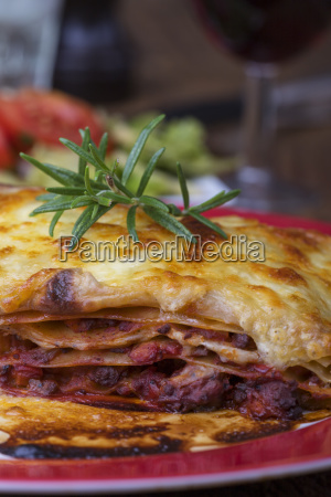 portion of lasagna with rosemary