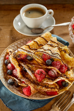 healthy fruit crepes with assorted berries