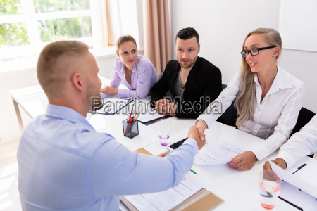 businessman shaking hands at interview