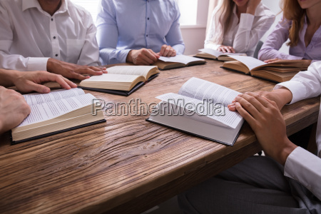 group of people reading bible