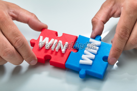 person connecting two win word puzzle