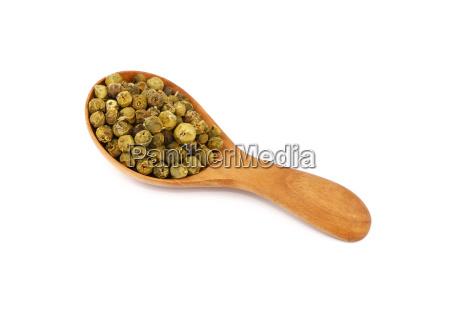 wooden scoop spoon full of green