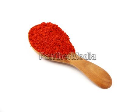 wooden scoop spoon full of red