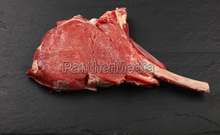 close up raw beef tomahawk ribeye
