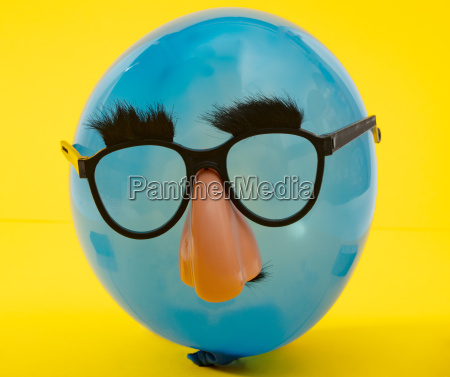 blue ballon with funny mask