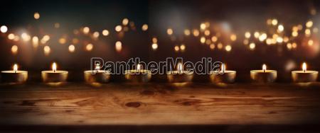 burning candles with celebratory bokeh