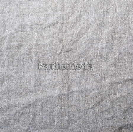 fragment of gray linen fabric crumpled