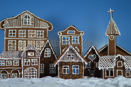 home made gingerbread village with cyan
