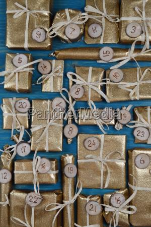 advent calendar with 24 golden presents