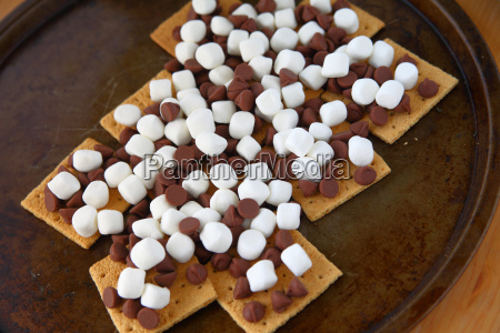 marshmallows and chocolate chips on graham