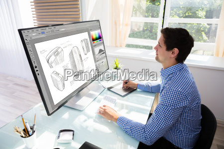 designer drawing suitcase on computer using