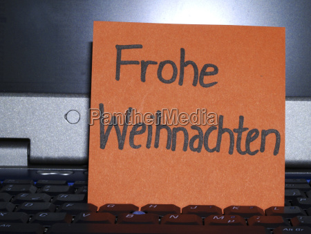 memo note on notebook frohe weihnachten