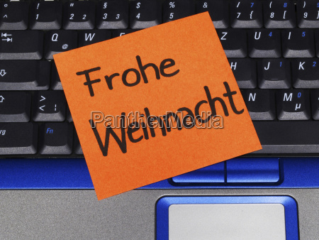 memo note on notebook frohe weihnacht