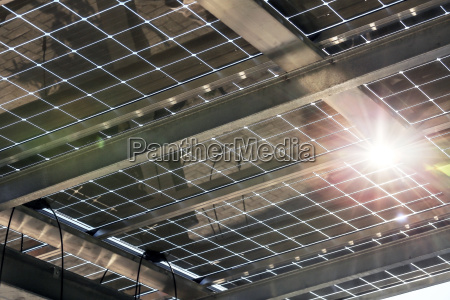 partially transparent glass modules on carport