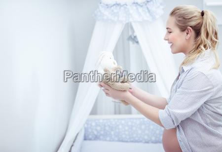 happy mother prepares childs room