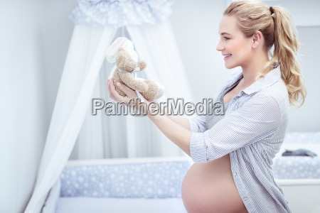 pregnant woman in childs room