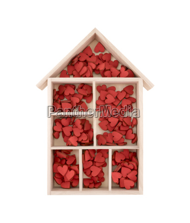 wooden house with many red hearts