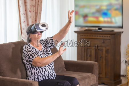senior woman with virtual headset or