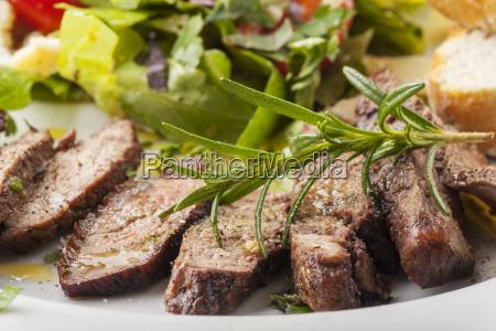 slices of a steak on fresh