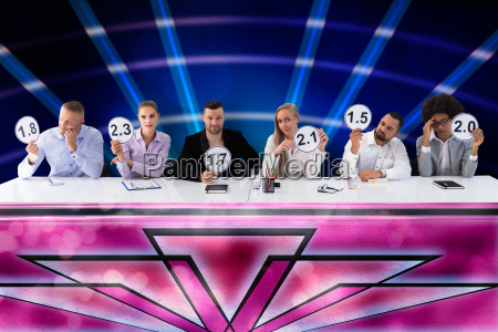 group of upset judges giving scores