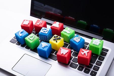 vivid icons cubic blocks on laptop