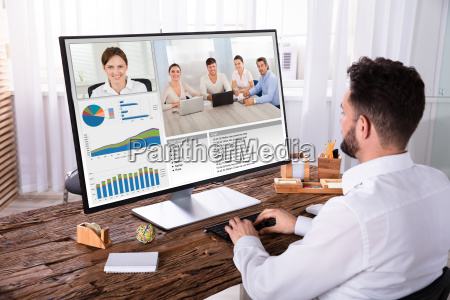 businessman video conferencing with his colleagues
