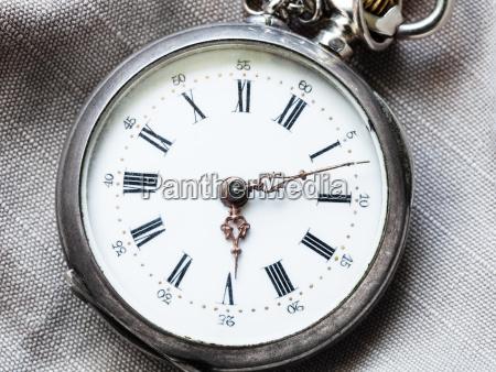 retro pocket watch on gray textile