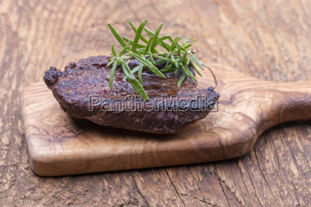 grilled steak on wood