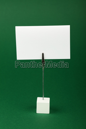 blank white paper sign over green