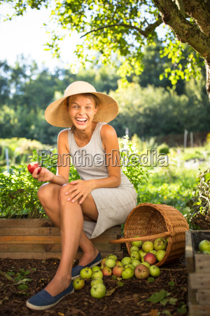 pretty young woman gardening in her