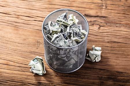 bank notes in dustbin