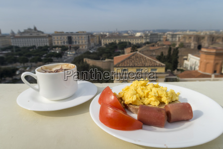 healthy breakfast with tomato sausage scramble