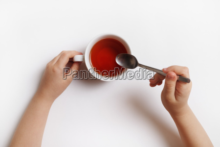 hands with cup of tea