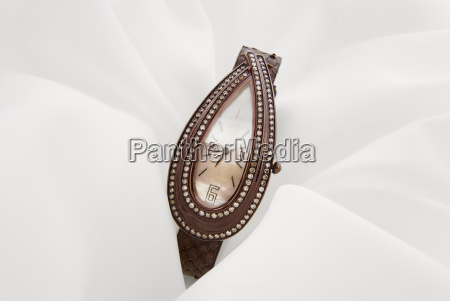 luxury watch with chocolate diamonds on