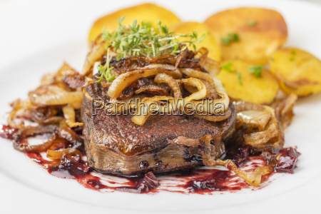 zwiebelrostbraten a german steak with onions