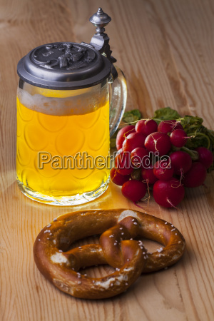 beer pretzel and radish on rustic
