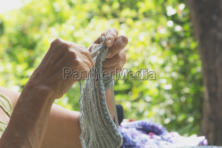the old woman knits woolen clothes