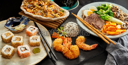 tables spread with traditional japanese cuisine