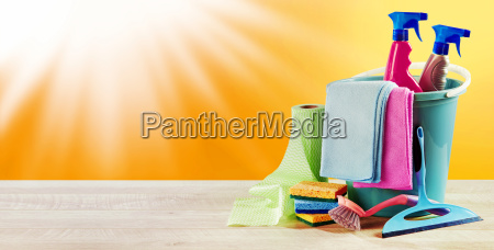 summer sun with domestic cleaning supplies