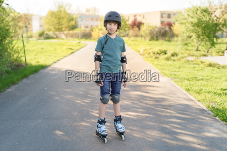 portrait of a boy on rollers