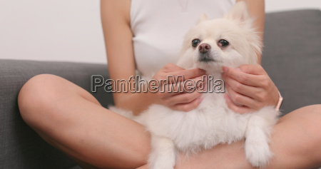 woman play with pomeranian dog