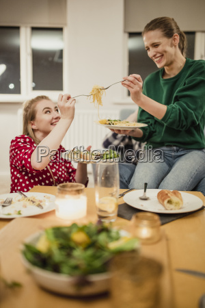 toasting spaghetti at a dinner party
