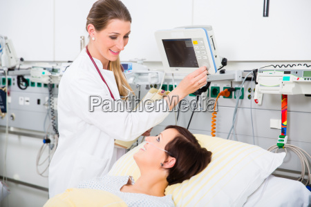 doctor in intensive medical care checking