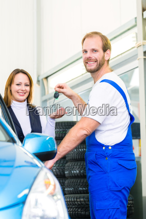 customer and car mechanic in auto