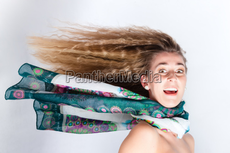 long hair of woman blown by