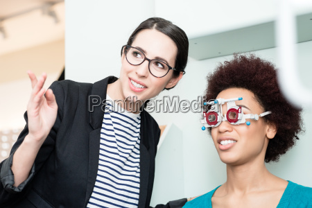 woman with optician at eyesight test