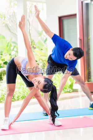 asian man and woman in fitness
